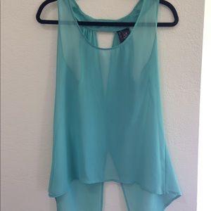 Flowy light blue shirt. Never worn, no tags